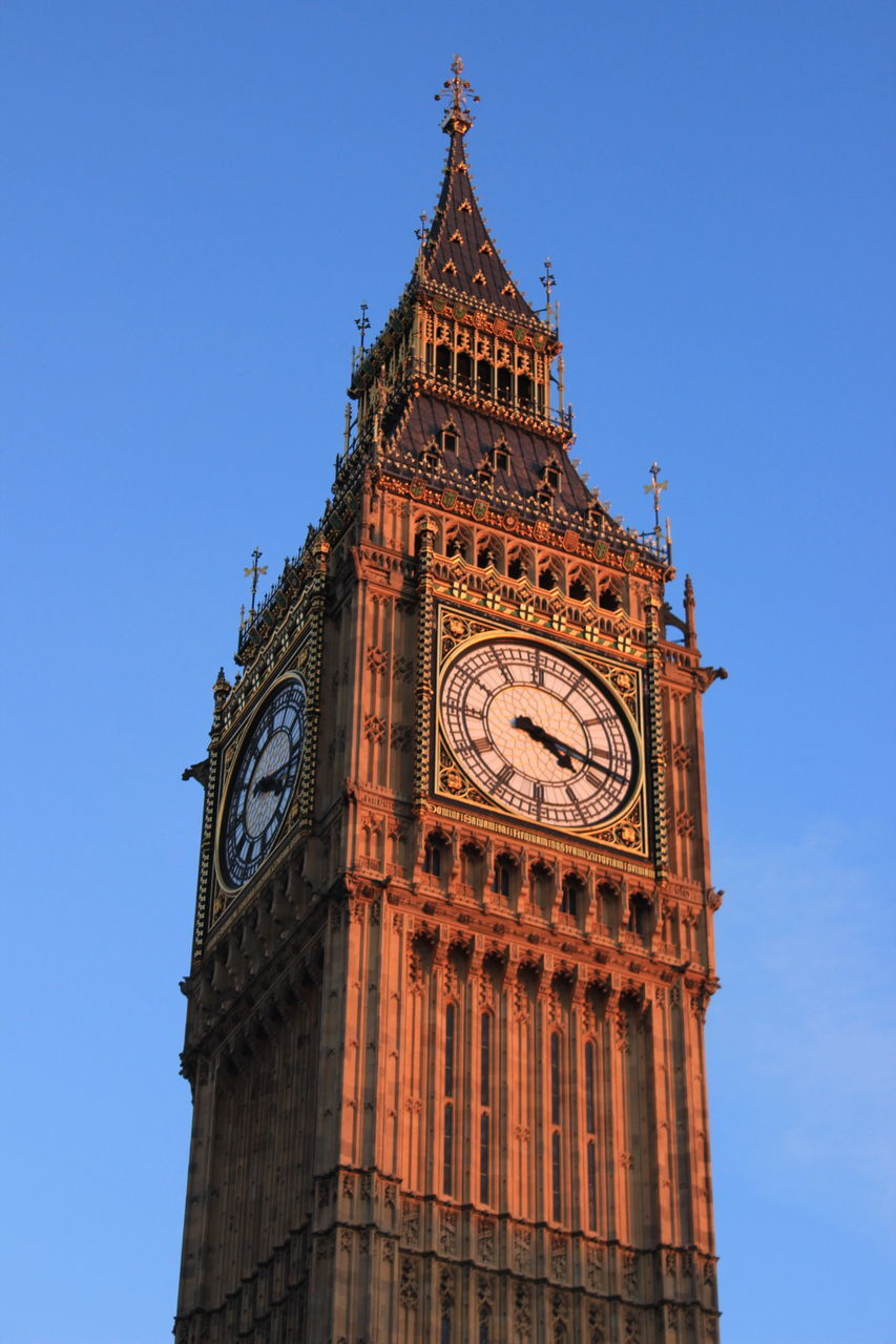 clock tower, architecture, low angle view, clock, tower, built structure, time, travel destinations, building exterior, history, clear sky, day, travel, blue, no people, outdoors, sky, city, clock face