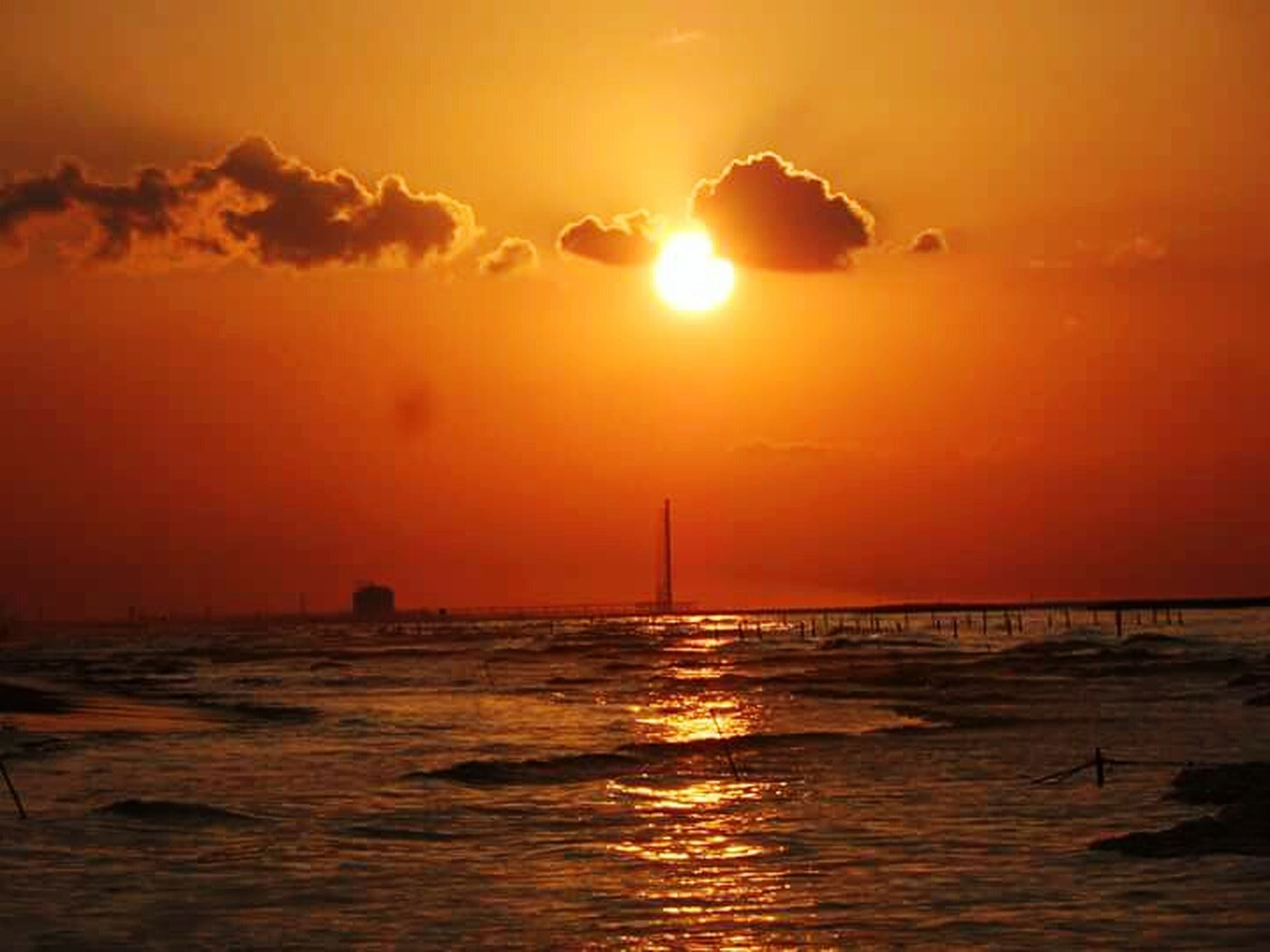 sunset, sea, orange color, water, sun, scenics, horizon over water, tranquil scene, beauty in nature, tranquility, waterfront, idyllic, sky, nature, reflection, silhouette, rippled, beach, remote, outdoors