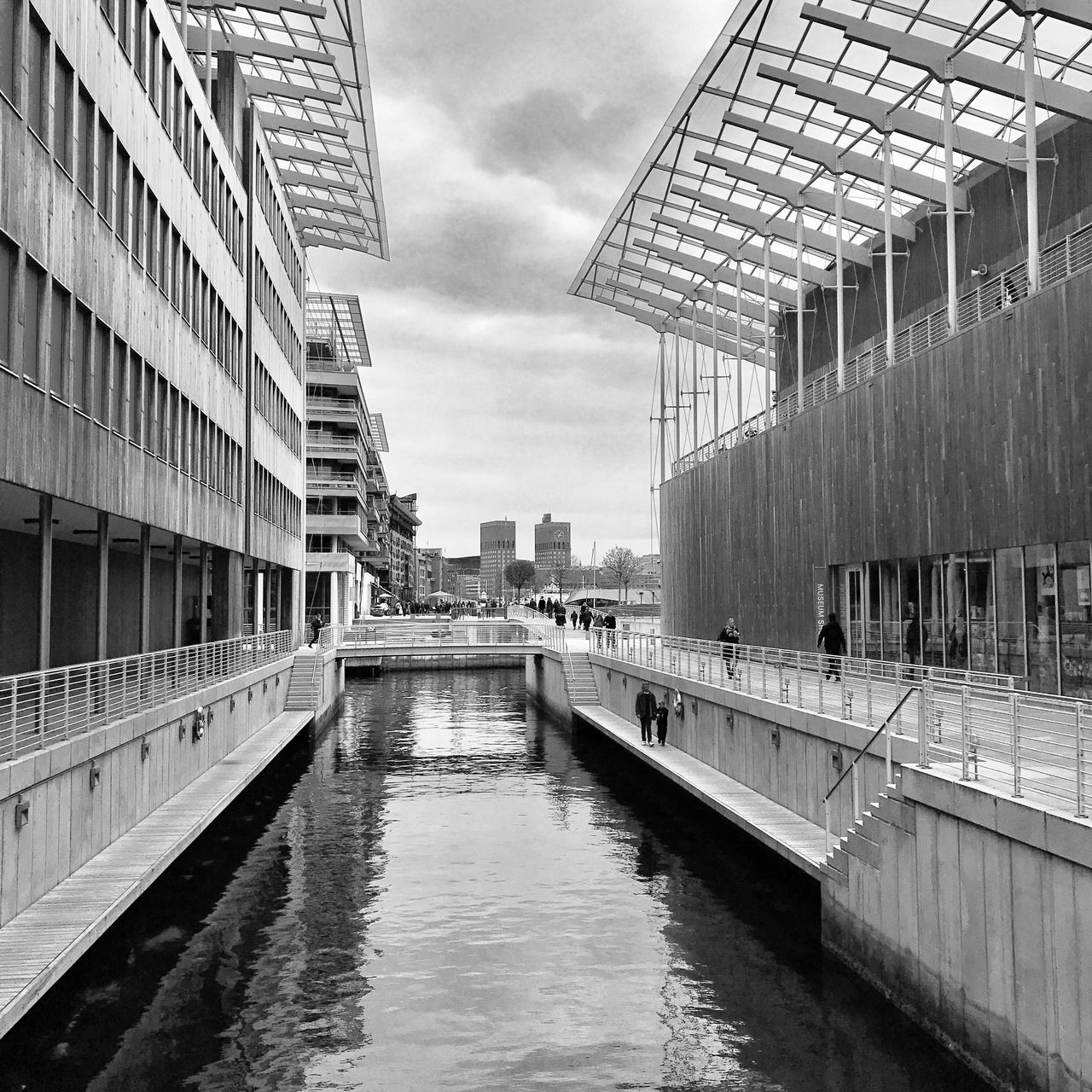 architecture, built structure, building exterior, sky, water, day, cloud - sky, reflection, no people, outdoors, waterfront, river, city, modern, travel destinations, nature