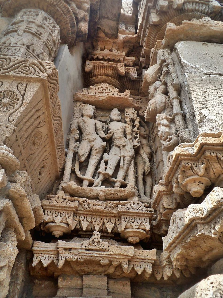RUKMANI MATA Temple,The exterior of the Rukmini Temple is richly carved. It has a panel of sculpted naratharas (human figures) and a panel of sculpted gajatharas (elephants) at the base Ancient Ancient Civilization Architectural Column Architectural Feature Architecture Art Art And Craft Bas Relief Building Exterior Built Structure Carved Carving Creativity Day Full Frame History Outdoors Place Of Worship Stone Stone Material The Past Tourism Travel Destinations Gujarat EyeEm Diversity Art Is Everywhere