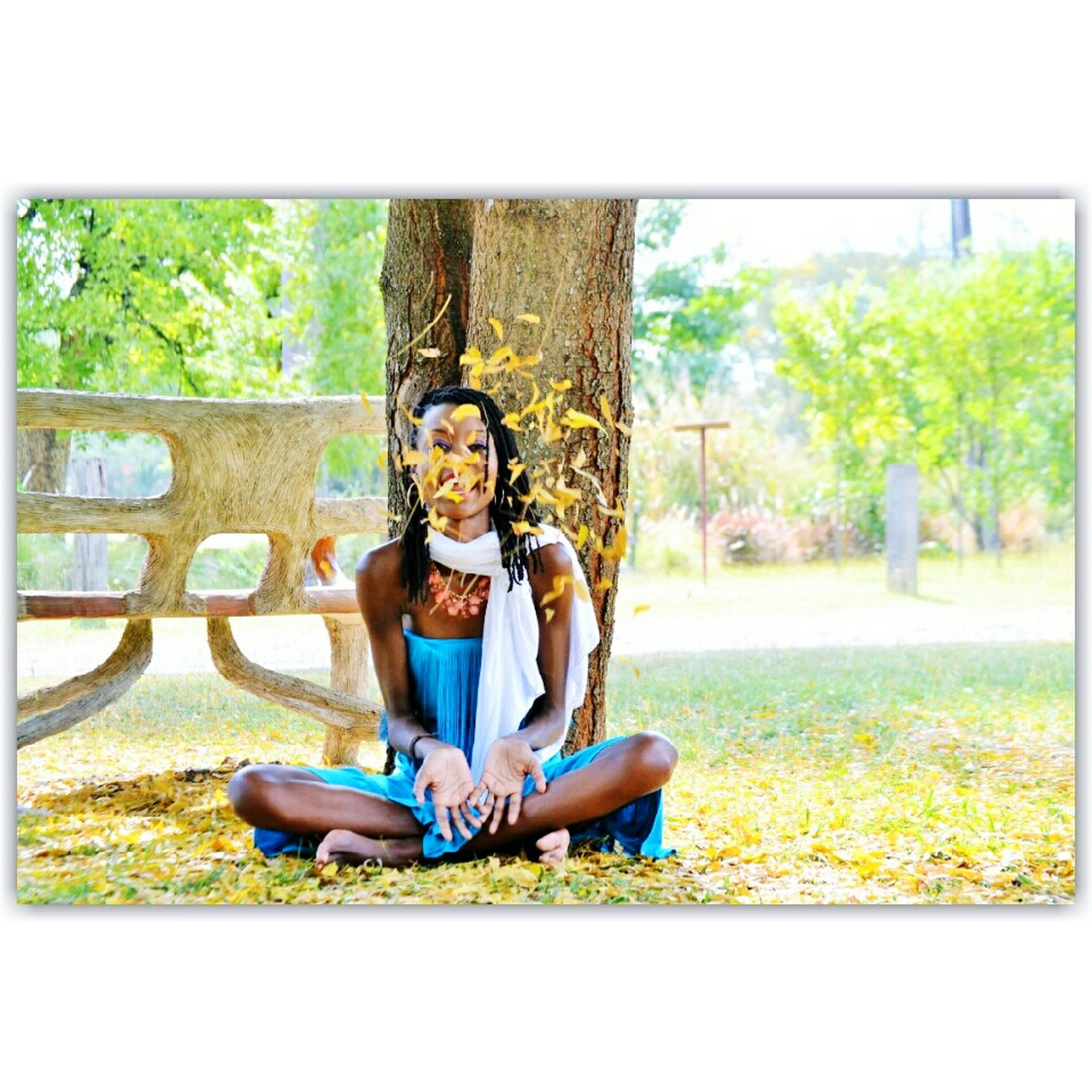 lifestyles, transfer print, sitting, tree, full length, leisure activity, casual clothing, auto post production filter, young adult, young women, park - man made space, relaxation, grass, person, standing, field, park