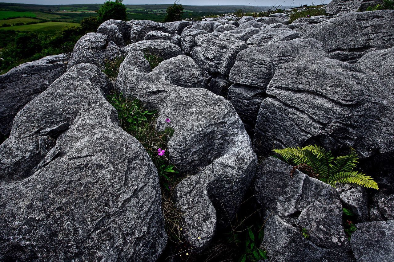 rock - object, textured, lava, no people, outdoors, nature, day, beauty in nature, close-up