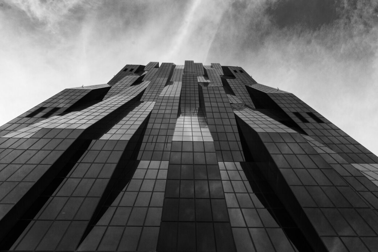 architecture, modern, skyscraper, building exterior, low angle view, built structure, tall, no people, sky, growth, city, day, outdoors
