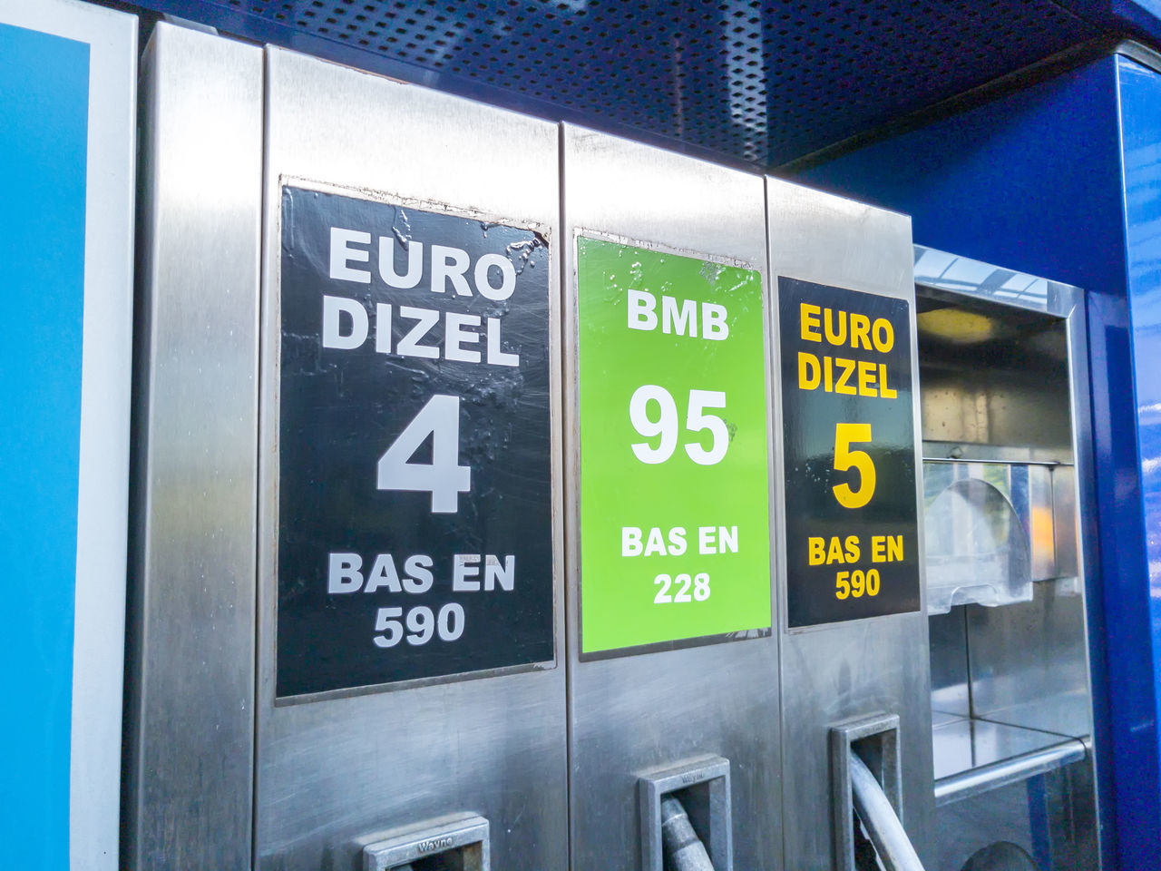 ZAGREB, CROATIA - MAY 10, 2017: Pump nozzles in gas station Benzine Diesel Fuel Gas Station Gasoline Nozzle Petrol Petroleum Pump Refill