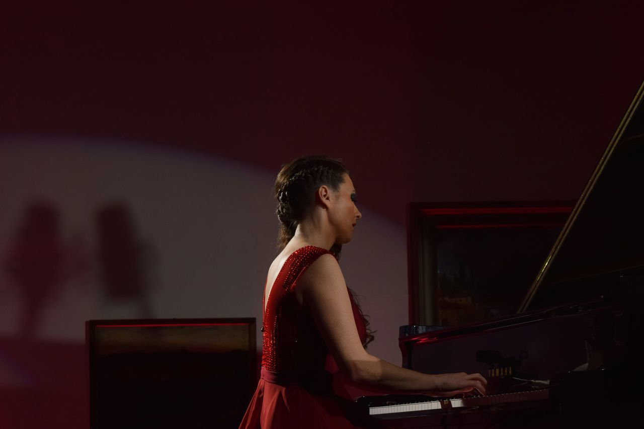Arts Culture And Entertainment Red Dress Concert Photography Piano Player Piano Performing Arts Event Classical Concert Dress Red Evening Gown Grand Piano Music Young Women Women Around The World Piano Moments