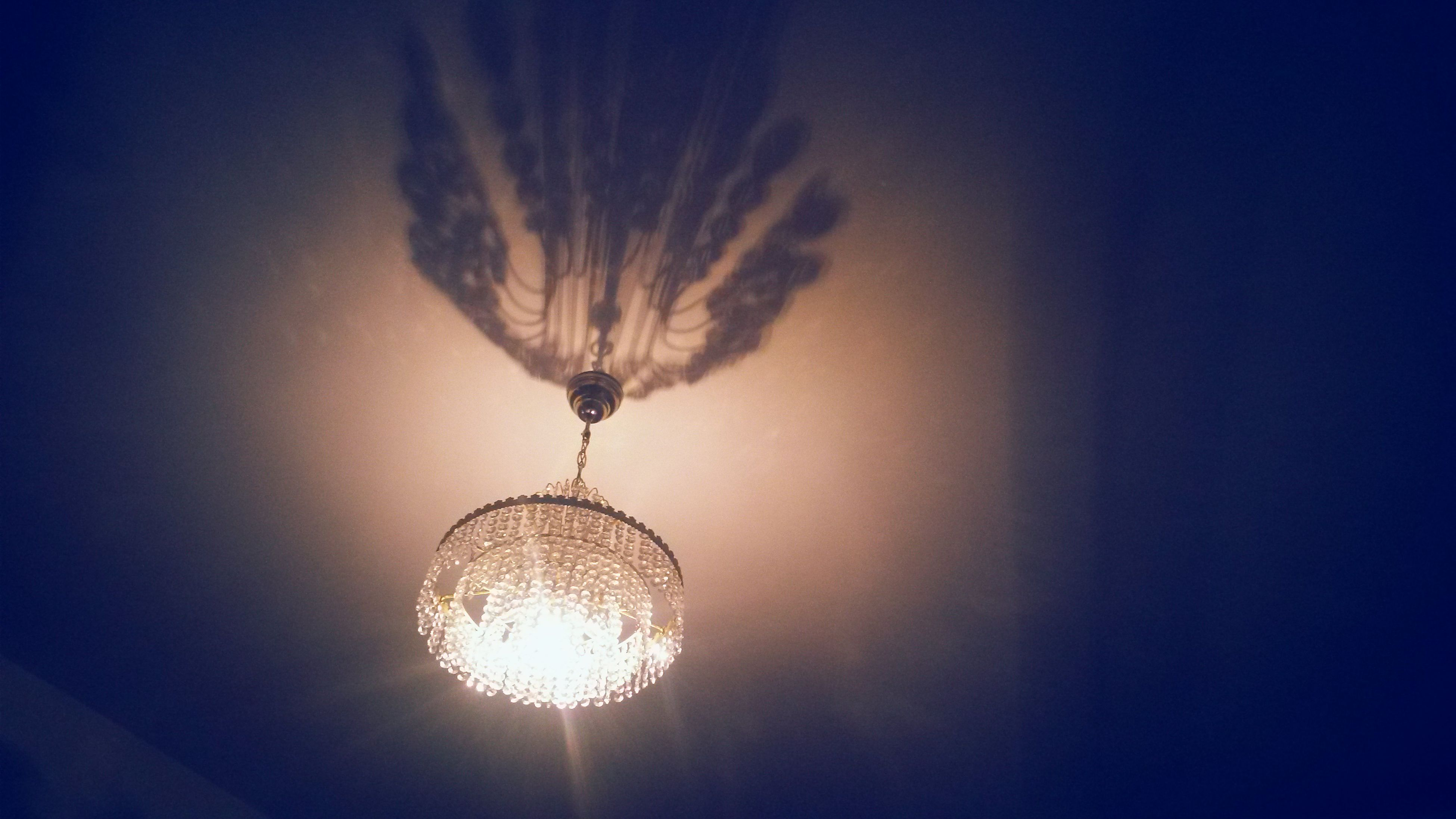 illuminated, lighting equipment, indoors, low angle view, ceiling, electricity, light bulb, electric light, hanging, glowing, light - natural phenomenon, electric lamp, decoration, close-up, chandelier, light, lit, glass - material, night, no people