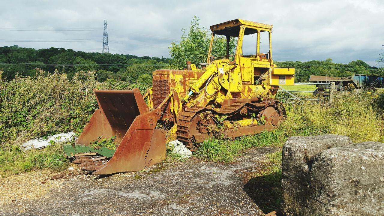 Old Rusty Bulldozer On Field