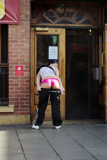 a girl flashing her knickers for the camera Bottom, Bottoms Up, City Girl, City Life Knickers, Flashing, Flasher, Pink, Reveal, Show Off,
