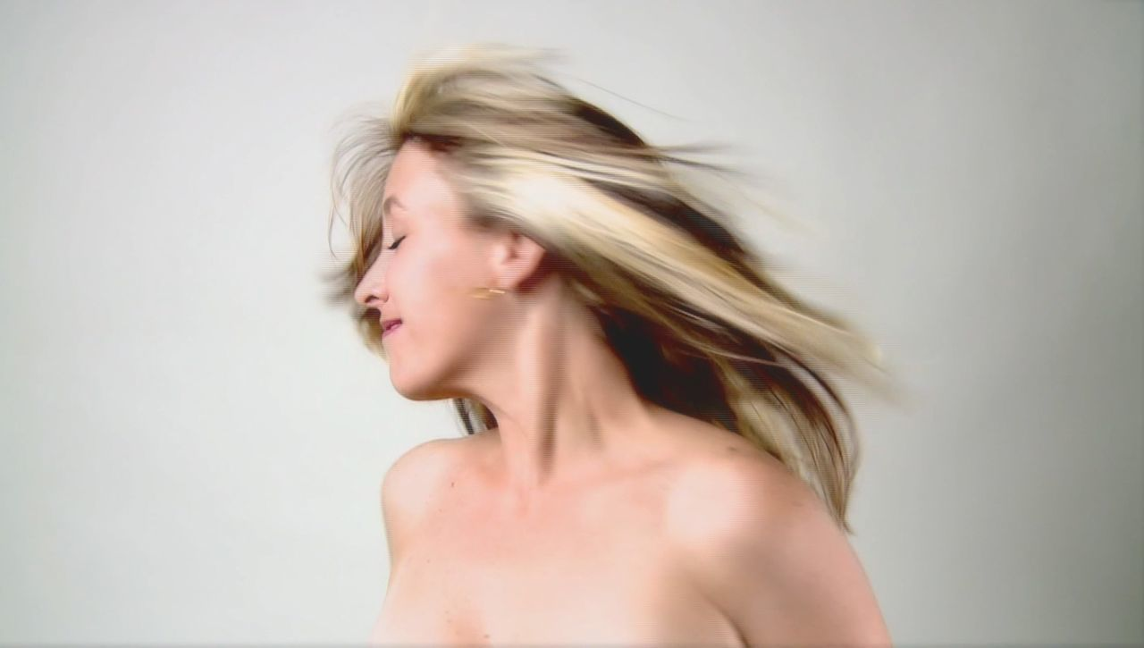 Still of my video installation entitled Blanca Palomita Beauty Blanca Palomita Contemplation Femininity Grace Quintanilla Leisure Activity Lifestyles Long Hair Medium-length Hair Portrait Sensuality Studio Shot Videoart White Background 43 Golden Moments Fine Art Photography