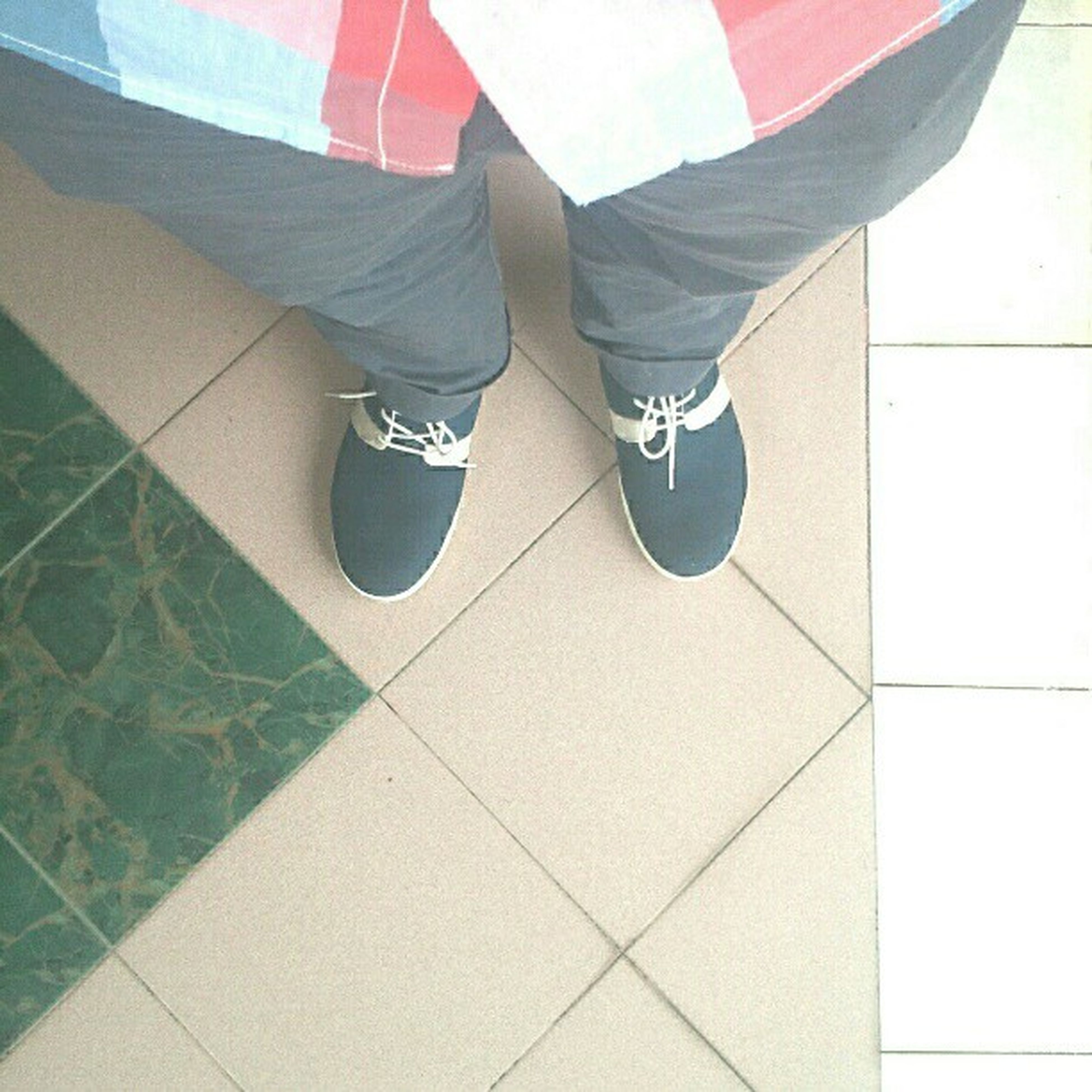 low section, person, lifestyles, shoe, tiled floor, standing, men, leisure activity, indoors, human foot, footwear, casual clothing, flooring, walking, jeans, tile
