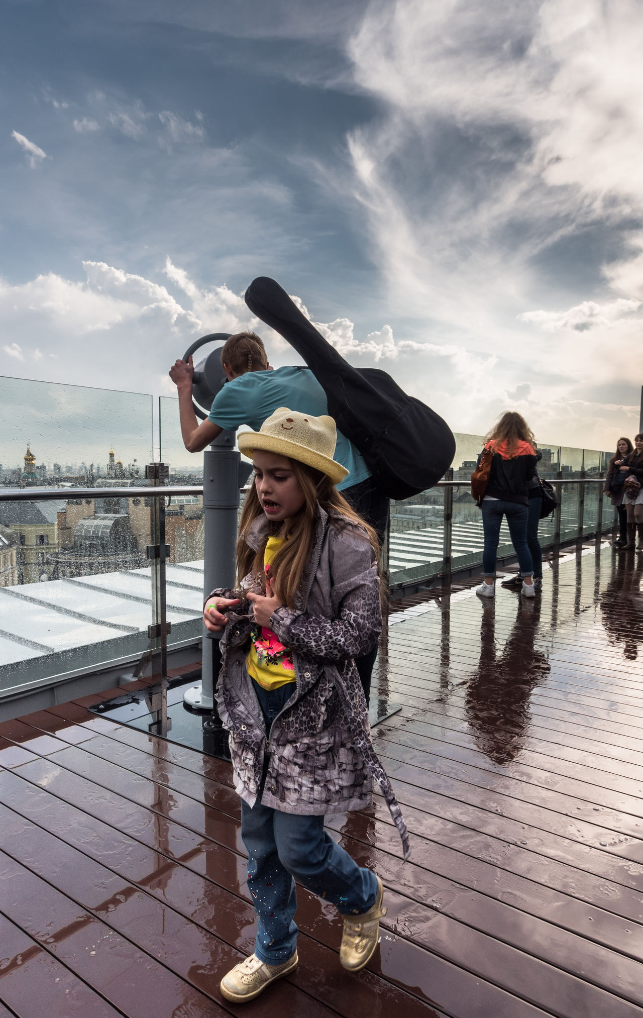 Russia, Moscow, Observatory on the roof of the store Children's world Casual Clothing Cloud Cloud - Sky Cloudy Day Enjoyment Full Length Fun Leisure Activity Lifestyles Outdoors Russia, Moscow, Observatory On The Roof Of The Store Children's World Sky Standing Warm Clothing Water