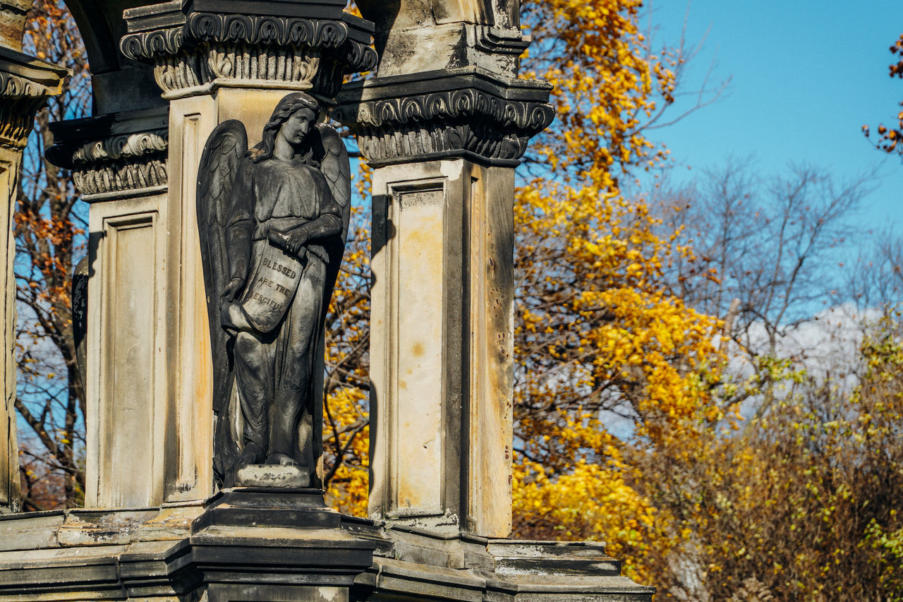 A beautiful Angel 18-105mm Angel Angel Wings Angels Architectural Detail Architecture Blue Cemetery Column Columns Details Low Angle View Mount Royal Cemetery Multi Colored No People Outdoors Sculpture Sky Sony A6300 Statue Tomb Travel Destinations Tree Tree Trees