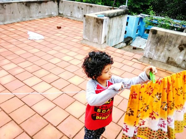 One Person Outdoors Standing Happiness Playing Elementary Age Real People Childhood Leisure Activity Helping Mom Be. Ready. Perspectives On People EyeEmNewHere Crafted Beauty EyeEm Ready