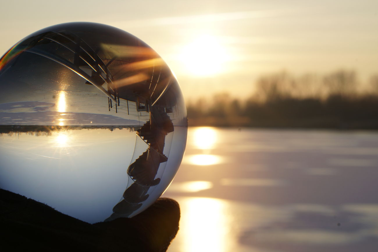 Reflection Sunset Water Sun Sky Nature Sea No People Sunlight Beauty In Nature Tranquility Illuminated Outdoors Travel Destinations Tree Sunbeam Crystal Ball Love♡ Landscape First Eyeem Photo Fantastic View Glass Reflection Glass Art Sunsets Lovelife