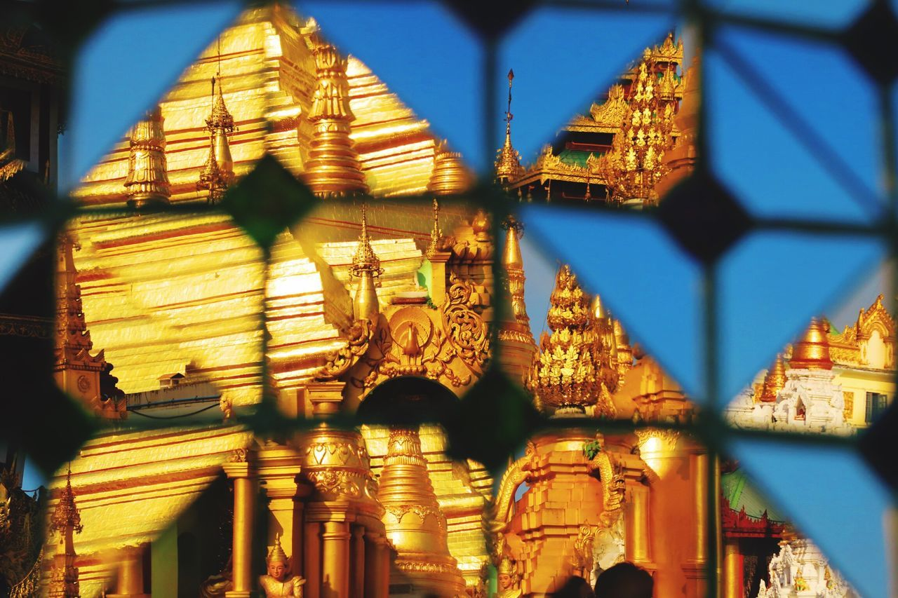 Puzzle of mirrors, Yangon, Myanmar. Built Structure Architecture Illuminated Place Of Worship No People Sky Building Exterior Spirituality Night Outdoors Temple Myanmar Travel Buddhist Temple Adventure Buddha Burma Backpacking ASIA Mirror Southeastasia Buddhism Gold EyeEm Best Shots EyeEm New Here