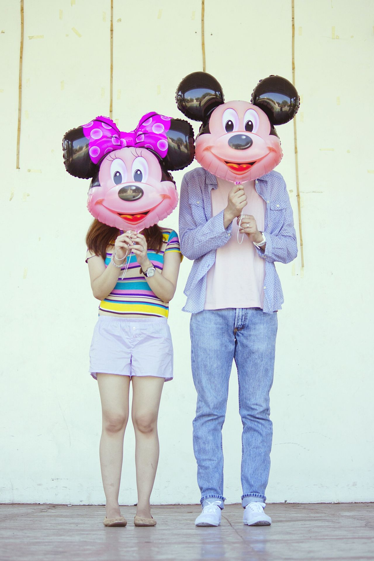 Full Length Front View Two People Adult Standing People Childhood Togetherness Indoors  Human Body Part Representing Portrait Happiness Friendship Couple Balloons Colorful Disney Fan EyeEmNewHere EyeEm Best Shots EyeEm Gallery