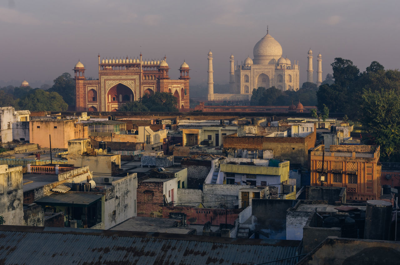 Not the usual perspective... Architecture Travel Destinations Built Structure Building Exterior City No People Place Of Worship Outdoors History Cityscape Sky India Agra Agra - India Taj Mahal Rooftop View  Early Morning Morning Light Pentax EyeEm Travel Photography Lonelyplanetindia Urban Travel Travel Photography