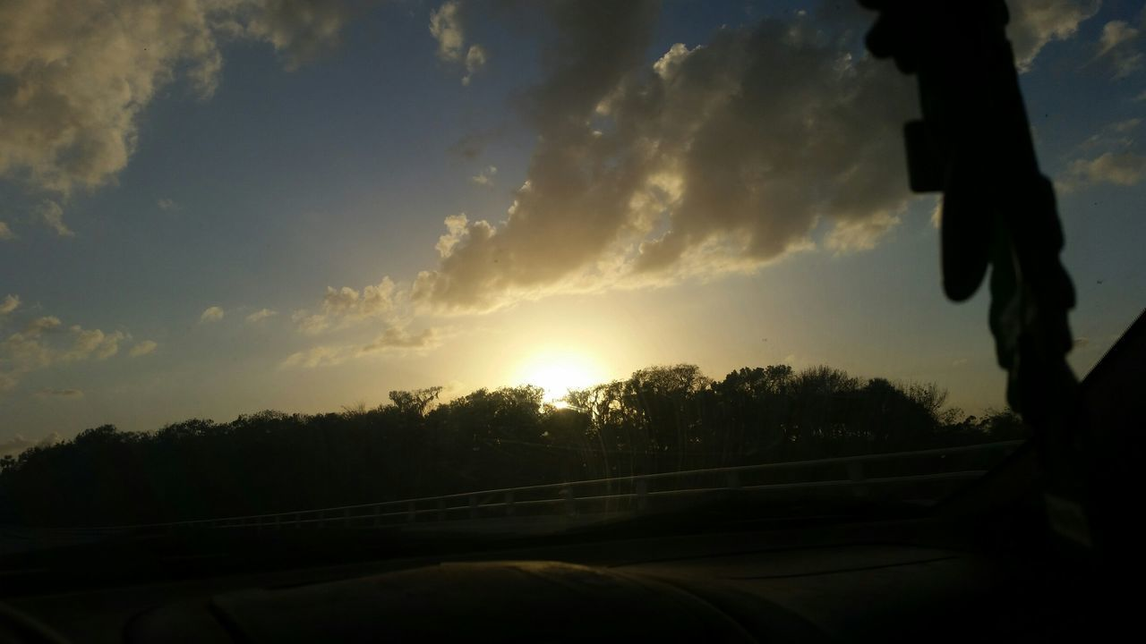 sunset, sky, transportation, car, road, silhouette, cloud - sky, land vehicle, sun, car interior, nature, tree, scenics, outdoors, no people, beauty in nature, low section, day