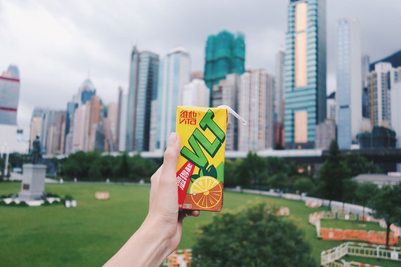 yummy Iced Tea Human Hand Human Body Part Holding City Architecture Building Exterior Focus On Foreground Built Structure Outdoors Close-up Hong Kong