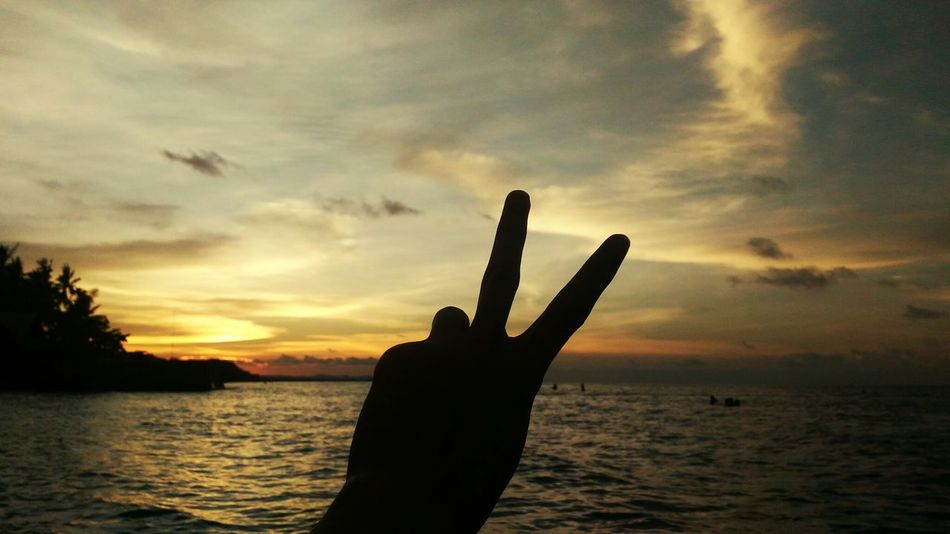 Beautiful Ending! Human Hand Human Body Part Sunset Hand Human Finger Silhouette Cloud - Sky Water Sea Sky People Touching Horizon Over Water One Person Sensory Perception Outdoors Palm Nature Adult Day Beach Only Black And White Photographs Onlyinthephilippines Arts Culture And Entertainment