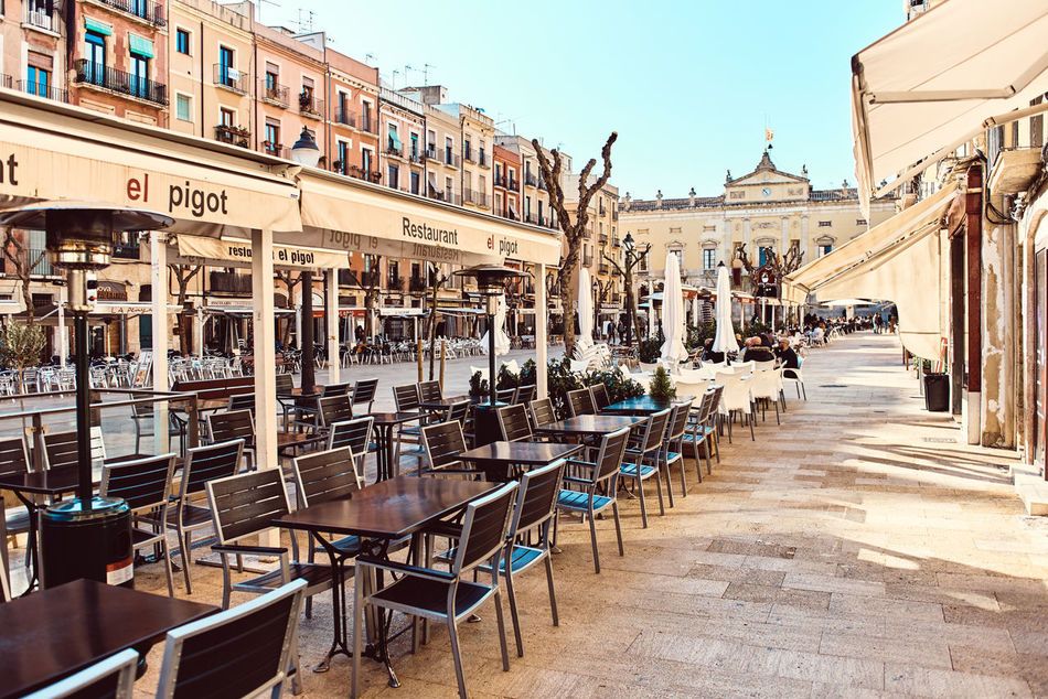 Tarragona, Spain- March 23, 2016: Town square in the old town center of Tarragona. It is popular touristic place, with a plenty of restaurants and bars Catalonia City City Center Editorial  Europe Exterior Famous Place Food And Drink History Landmark Main Square Old Town Open Air Cafe Outdoors Restaurant Pedestrian Street People Sidewalk Cafe SPAIN Square Street Sunny Day Tarragona Travel Destinations Urban Walkway