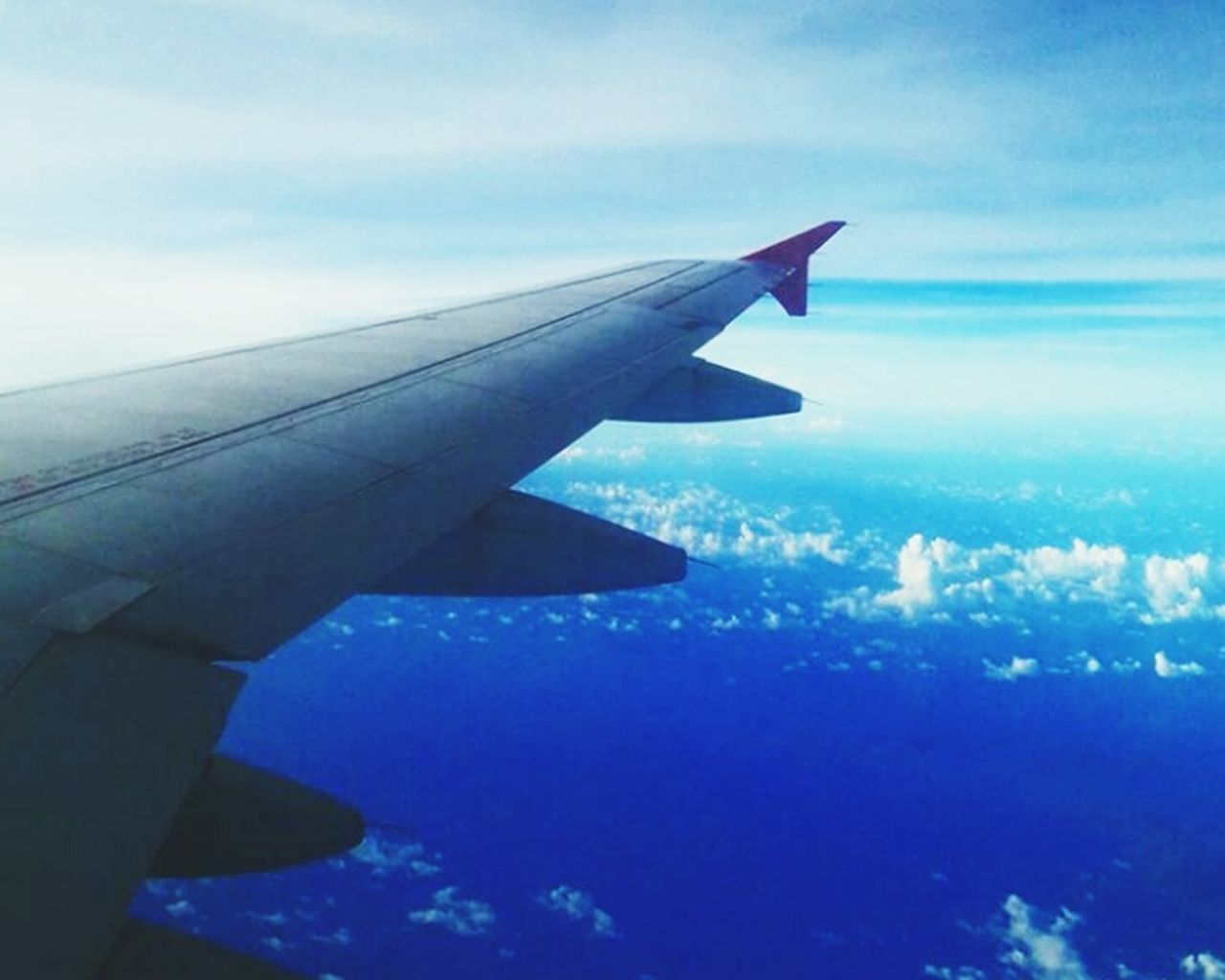 airplane, sky, transportation, cloud - sky, aircraft wing, aerial view, no people, air vehicle, blue, flying, outdoors, day, nature, close-up, airplane wing