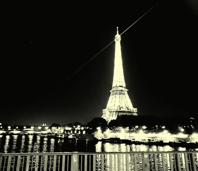 Architecture Built Structure Tourism Travel Destinations International Landmark Famous Place Night Illuminated Eiffel Tower City Travel Capital Cities  Tower Culture Reflection Sky Water Tall - High Engineering Outdoors France 🇫🇷 Paris ❤ People Of EyeEm People And Places. Battle Of The Cities
