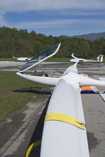 glider sailplane on ground Aerodrome Plane Wing Air Vehicle Airfield Airplane Close-up Glider Gliders Ground Mode Of Transport No People Parked Runway Sailplane Stationary Transportation Wings