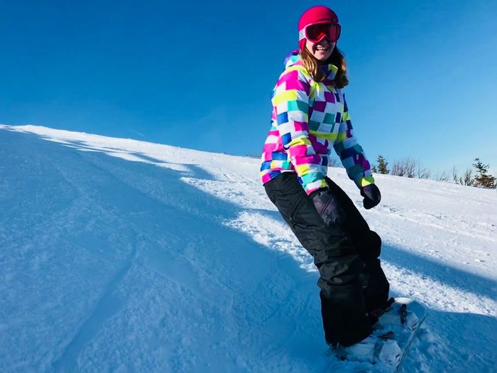 Beauty In Nature Blue Clear Sky Cold Temperature Day Full Length Happiness Leisure Activity Lifestyles Nature One Person Outdoors People Real People Scenics Ski Holiday Sky Smiling Snow Sport Sunlight Vacations Warm Clothing Winter Young Adult