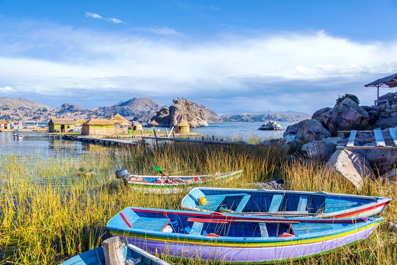 Colorful boats near floating islands on Lake Titicaca near Copacabana, Bolivia American Background Boats Bolivia Color Colorful Copacabana Floating Houses Inca Indigenous  Islands La Paz Lake Latin Native Nature Pattern Peru South America Titicaca Titicaca Lake Traditional Travel World