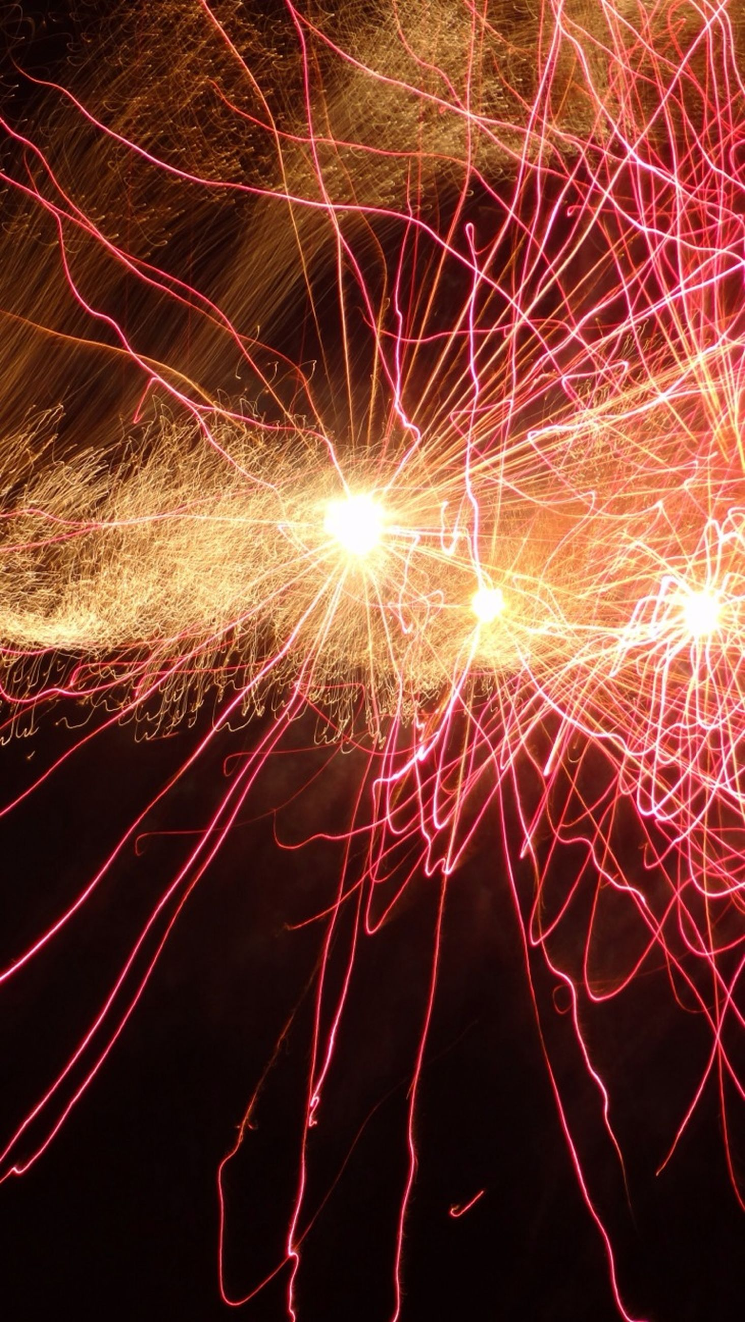 night, illuminated, glowing, long exposure, celebration, firework display, light, low angle view, exploding, red, abstract, dark, backgrounds, full frame, firework - man made object, motion, firework, arts culture and entertainment, lighting equipment, pattern