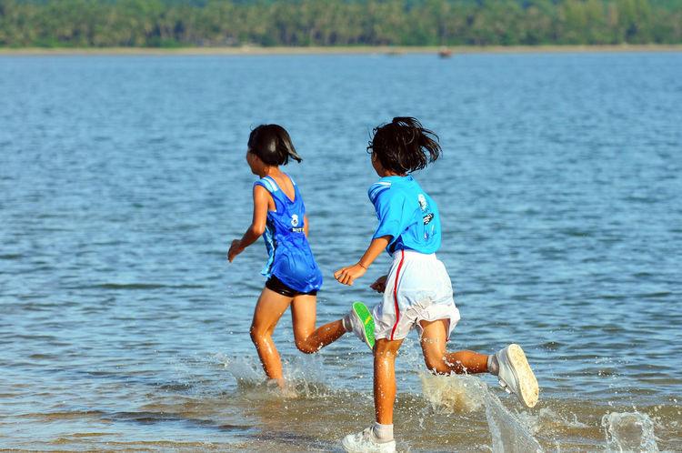 Asian Culture Athlete Beach Chumphon Cross Sea Running Day Funrun Langsuan Traditional Long Boat Racing Festival, Thailand Marathon Runner Ocean Outdoors People Physical Activity Pithak Island Pithak Island Runner Running Sea Sky Sport Street Thai Water Women วิ่งแหวกทะเลสู่เกาะพิทักษ์