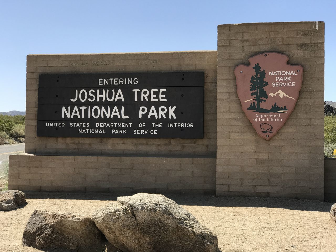 ©Amy Boyle Photography Architecture Building Exterior Built Structure Communication Day Joshua Tree National Park National Park No People Outdoors Placard Rock - Object Sky Sunlight Text Welcome Sign Western Script