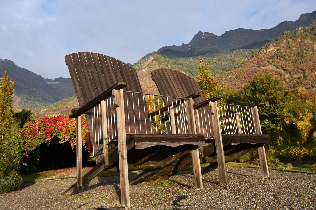 Two big Chairs .autumn in park in the mountains alps near merano southtyrol italy Abstract Alps Arch Autumn Autumn Colors Autumn Leaves Bright Brown Change Foliage Garden Gazebo Merano Nature Orange Outdoors Park Pathway Pergola Relaxing Season  Texture Tree Walkway