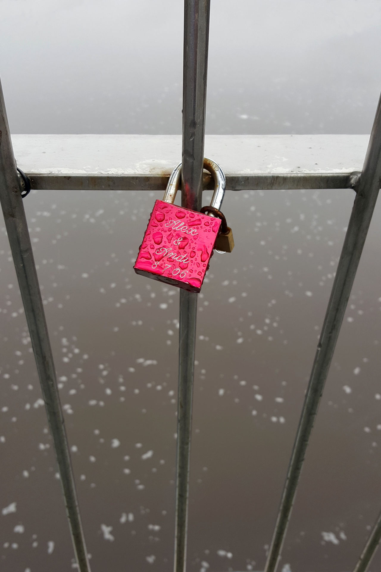 "Coming to a bridge near you! (""Love locks"" are taking over bridges all over the world.) Baby Bridge Lock Love Love Locks Metal Outdoors Padlock Padlocks Padlocks On Bridge Pink Pink Color River Water With Child Millennial Pink"