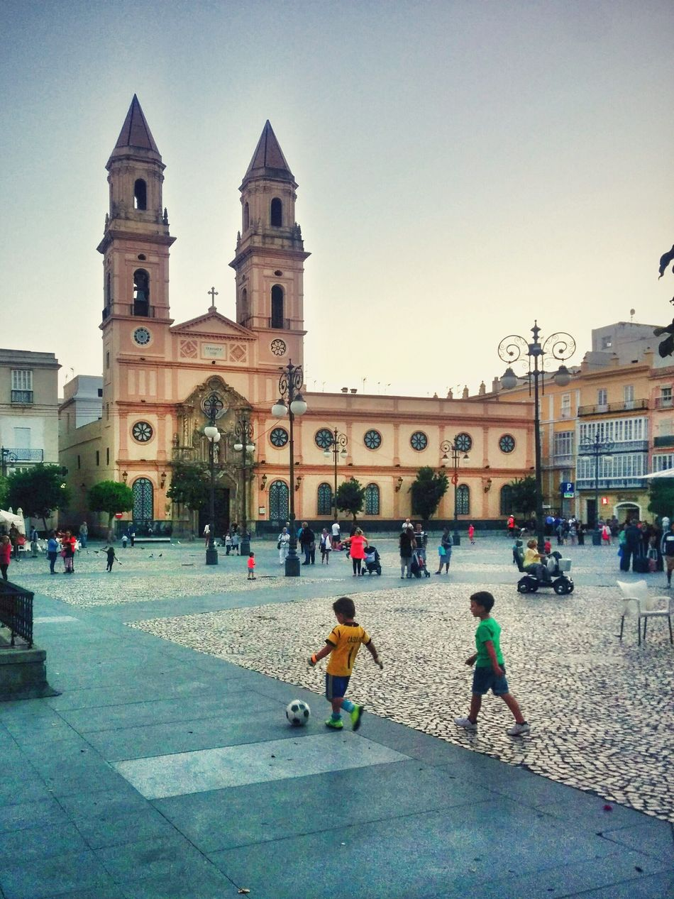 Kids Playing on a Beautiful Day. Spanish Arquitecture Plaza Life On The Streets