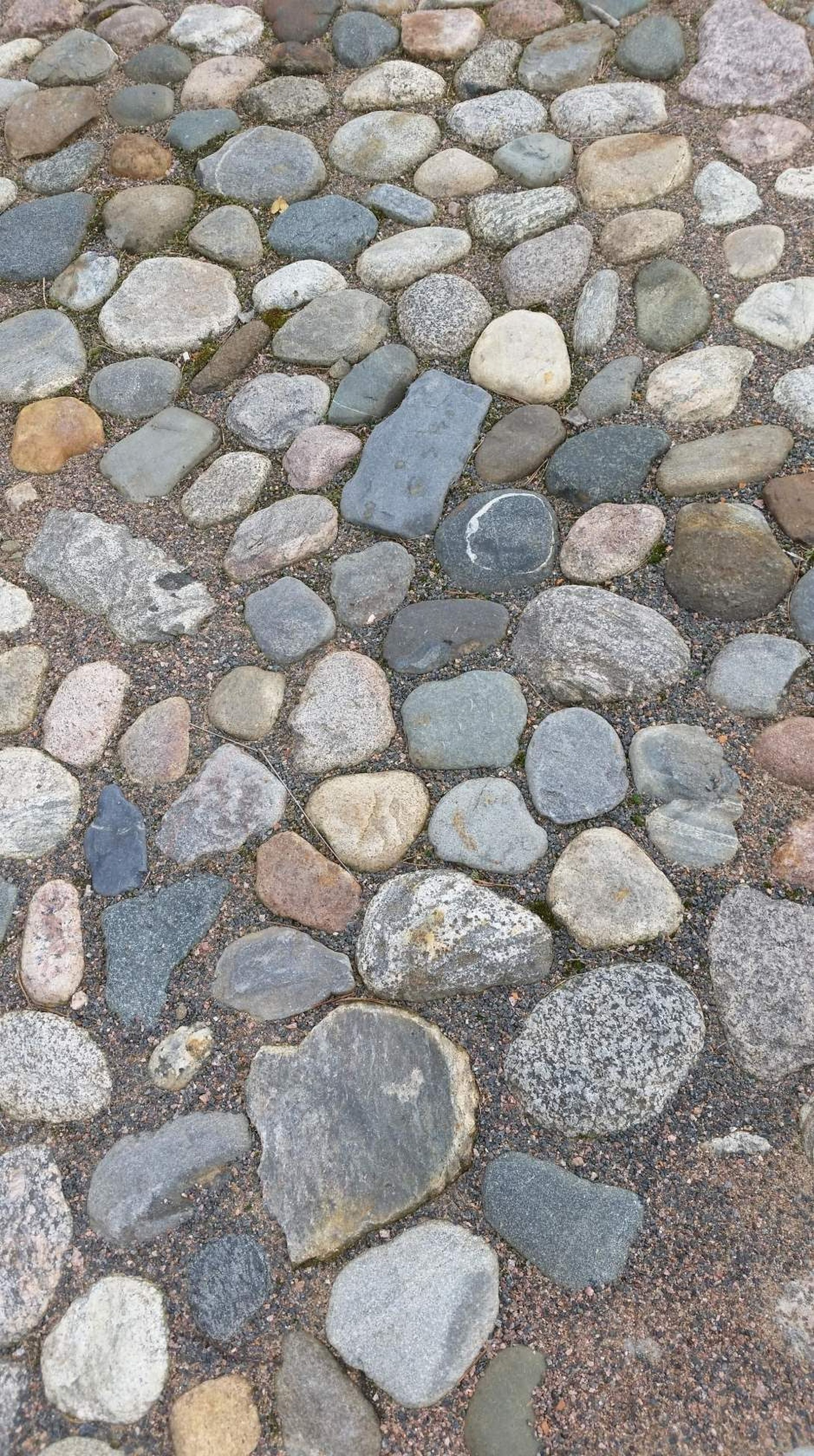 backgrounds, full frame, stone - object, textured, high angle view, stone material, day, paving stone, multi colored, footpath, outdoors, pebble, large group of objects, no people, extreme close up