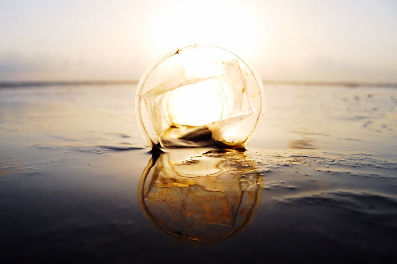 reflection, crystal ball, water, sea, sphere, horizon over water, beach, sand, sunset, no people, close-up, nature, crystal, waterfront, outdoors, sky, beauty in nature, day