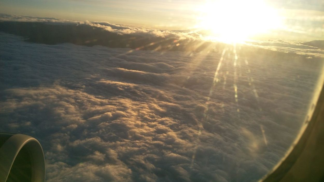 Flying Over Clouds Sunset over Atlantic Ocean