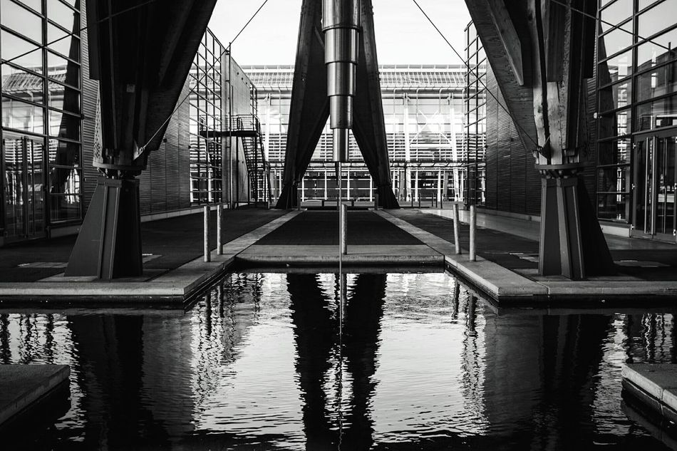 ~ 🍃✴~ Reflection Architecture Built Structure Day Outdoors Modern Sky City No People Geometric Shapes Architectural Detail Canonphotography Black And White Modern Architecture Architectural Feature Water Reflections Connection Business Finance And Industry Getting Inspired Lines And Shapes Black & White Light And Shadow Monochrome Metal Structure Moment Of Zen