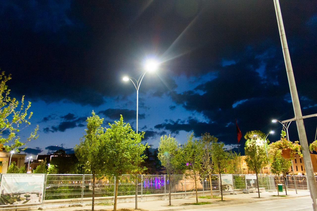 street light, illuminated, night, sky, tree, outdoors, no people, floodlight, building exterior, nature