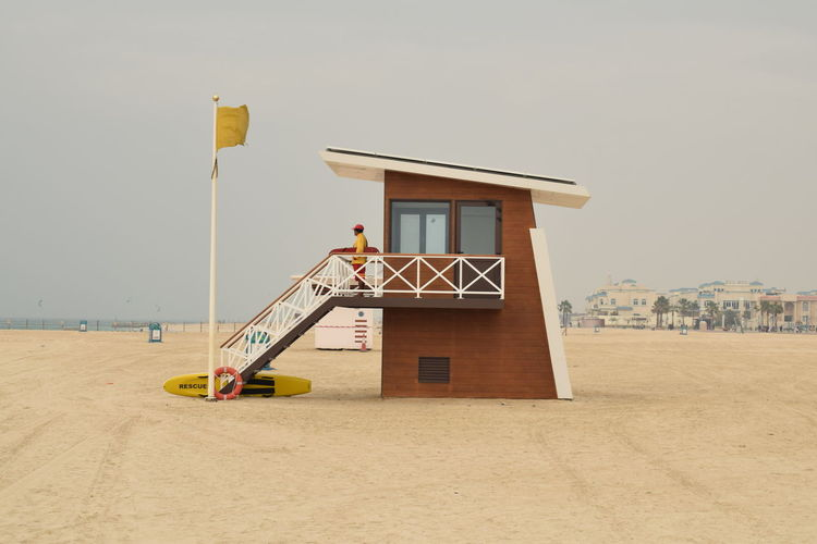 Lifeguard tower, Dubai beach Beach life Baywatch Beach Life Dubai Dubai Beach Dubai Marina On Duty Sightseeing Work Working Baywatch Tower Beach Day Lifeguard Hut Lifeguard On Duty Lifeguard Station Lifeguard Tower Ocean Outdoors Pastel Colors Sand Sea Tourism Vacation Yellow