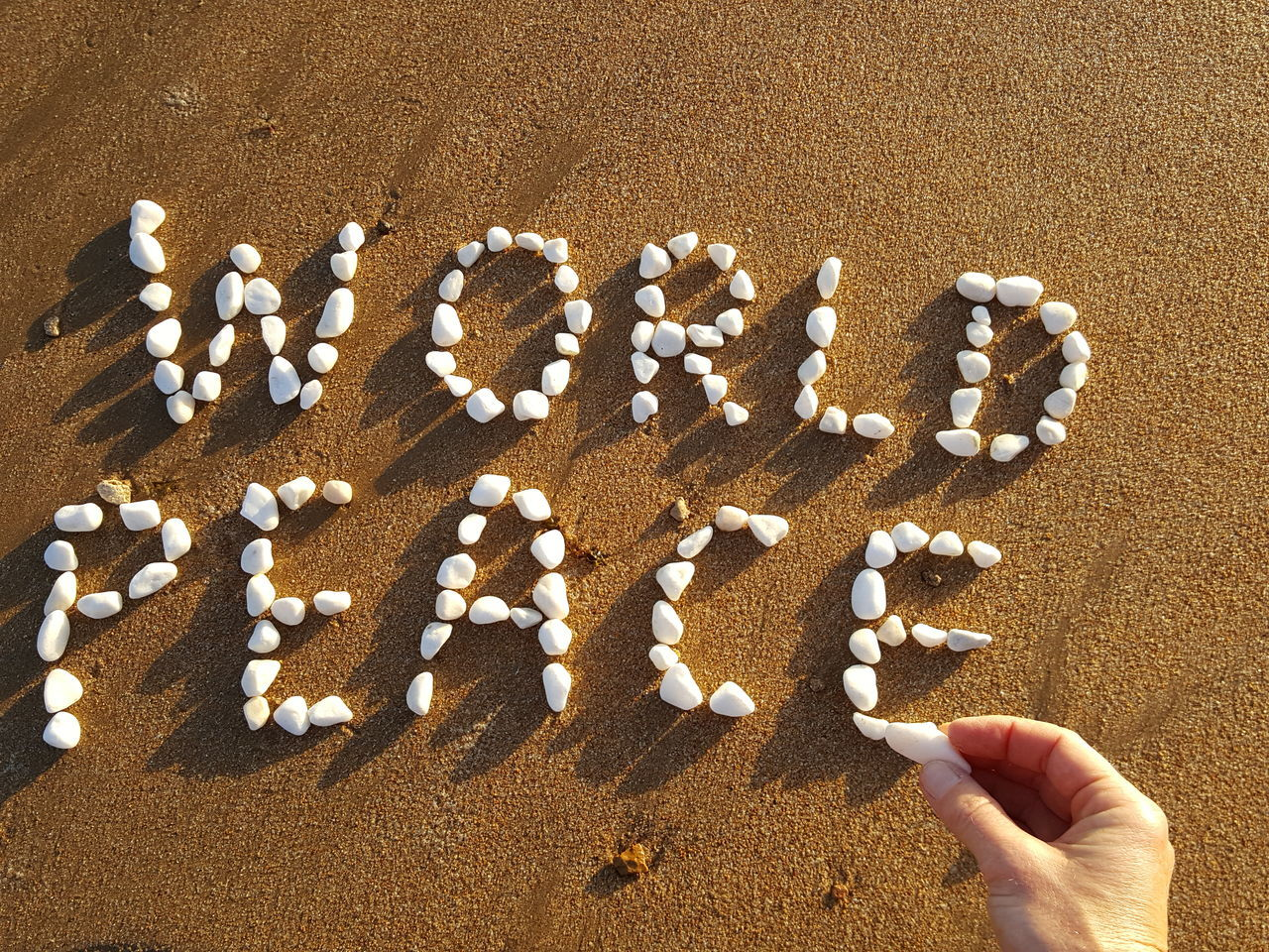 Human Hand Human Body Part Lifestyles Sand Scripture Writing Wish Wishes Peace Peace In The World World Peace World Peace Wish Words Letters Words With Stones Pebbles Pebbles On A Beach Pebbles And Sand Pebbles Pattern Words With Pebbles