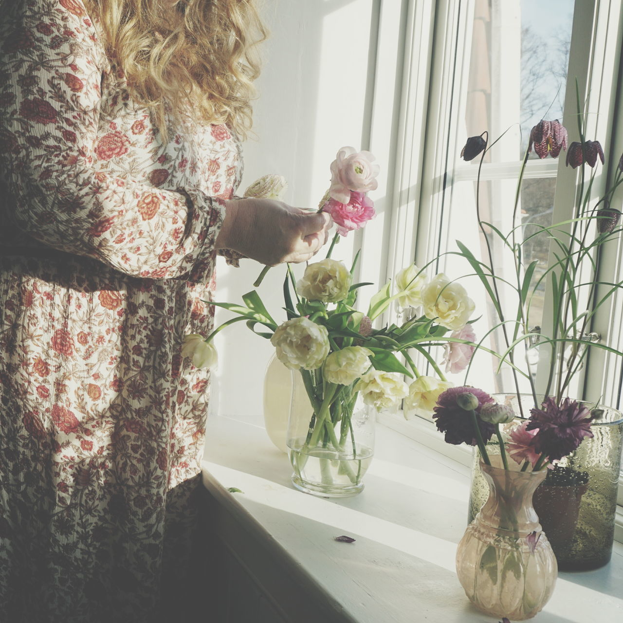 Making a bouquet of Spring flowers Adult Adults Only Beauty In Nature Bouquet Day Domestic Life Flower Flower Arrangement Flower Head Fragility Freshness Growth Home Interior Indoors  Nature One Person One Woman Only Only Women People Plant Real People Spring Vase Watering Women