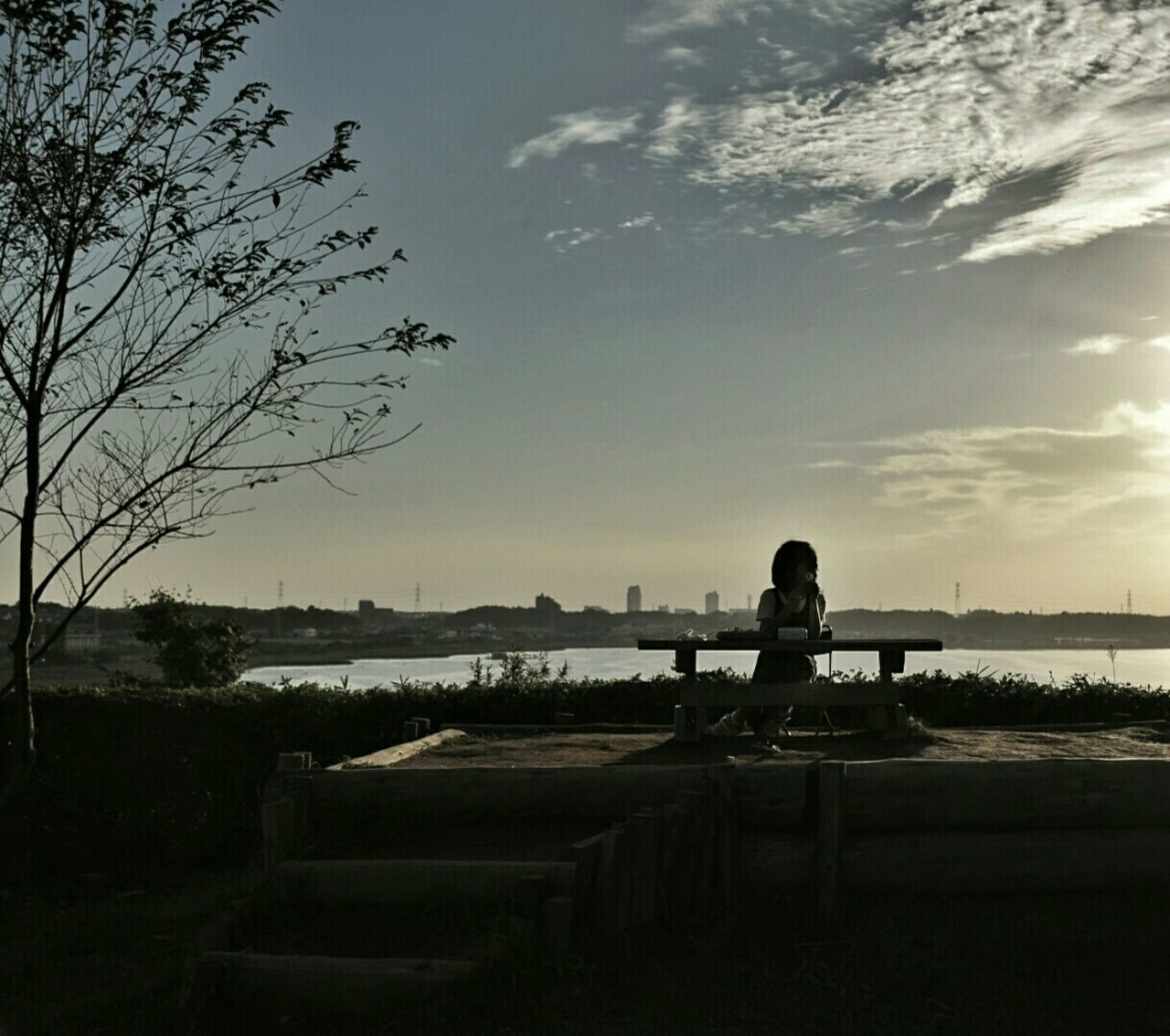 sky, water, sitting, nature, one person, silhouette, real people, tranquil scene, scenics, beauty in nature, river, sunset, outdoors, tranquility, tree, leisure activity, landscape, beach, day, people