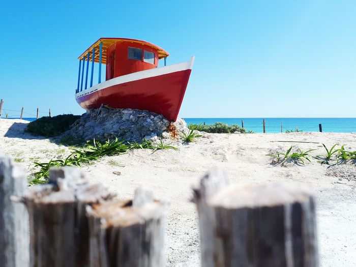 EyeEm Selects Beach Sunny Vacations Water Nature Travel Destinations Boat Sky Sea Outdoors Day Summer Sand No People Blue Horizon Over Water Nautical Vessel Clear Sky Beauty In Nature