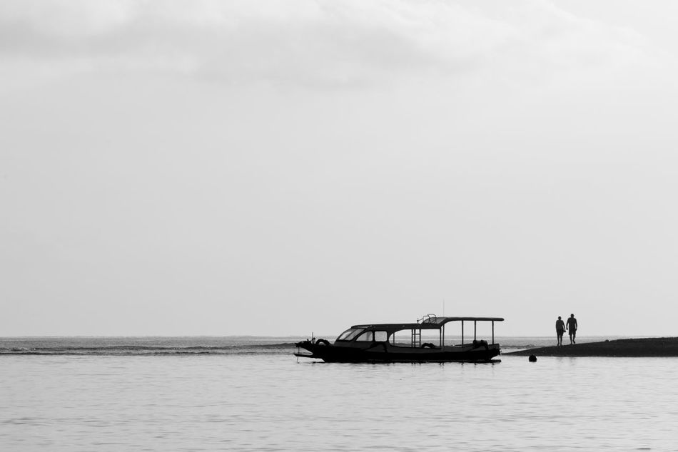 Holidays Art Is Everywhere Bali Bali, Indonesia Beach Black & White Black And White Boat Bw Bw_collection Couple EyeEm Best Shots - Black + White Holiday Holidays Nature Scenics Sea Silhouette Silhouette_collection Silhouettes The Secret Spaces Tranquil Scene Tranquility Unrecognizable Person Water
