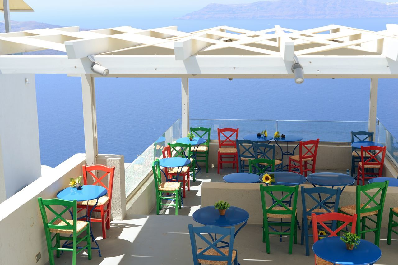chair, table, in a row, day, beach, no people, absence, outdoors, multi colored, arrangement, sunlight, sea, seat, nature