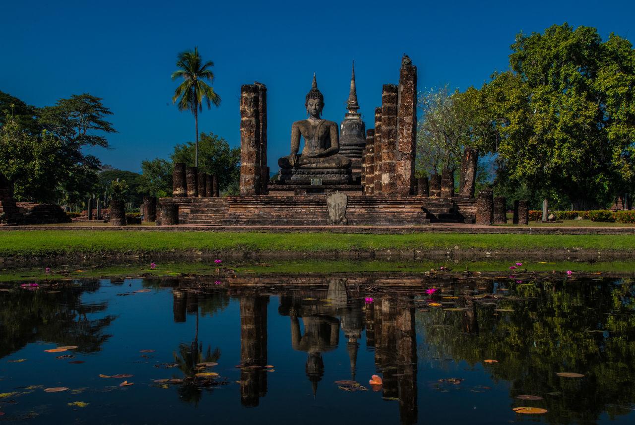 Thailand Sukhothai Sukhothaihistoricalpark Reflection Religion Architecture Travel Destinations Spirituality Cultures Tourism Built Structure Sky Reflection Lake Outdoors Tropical Climate Water
