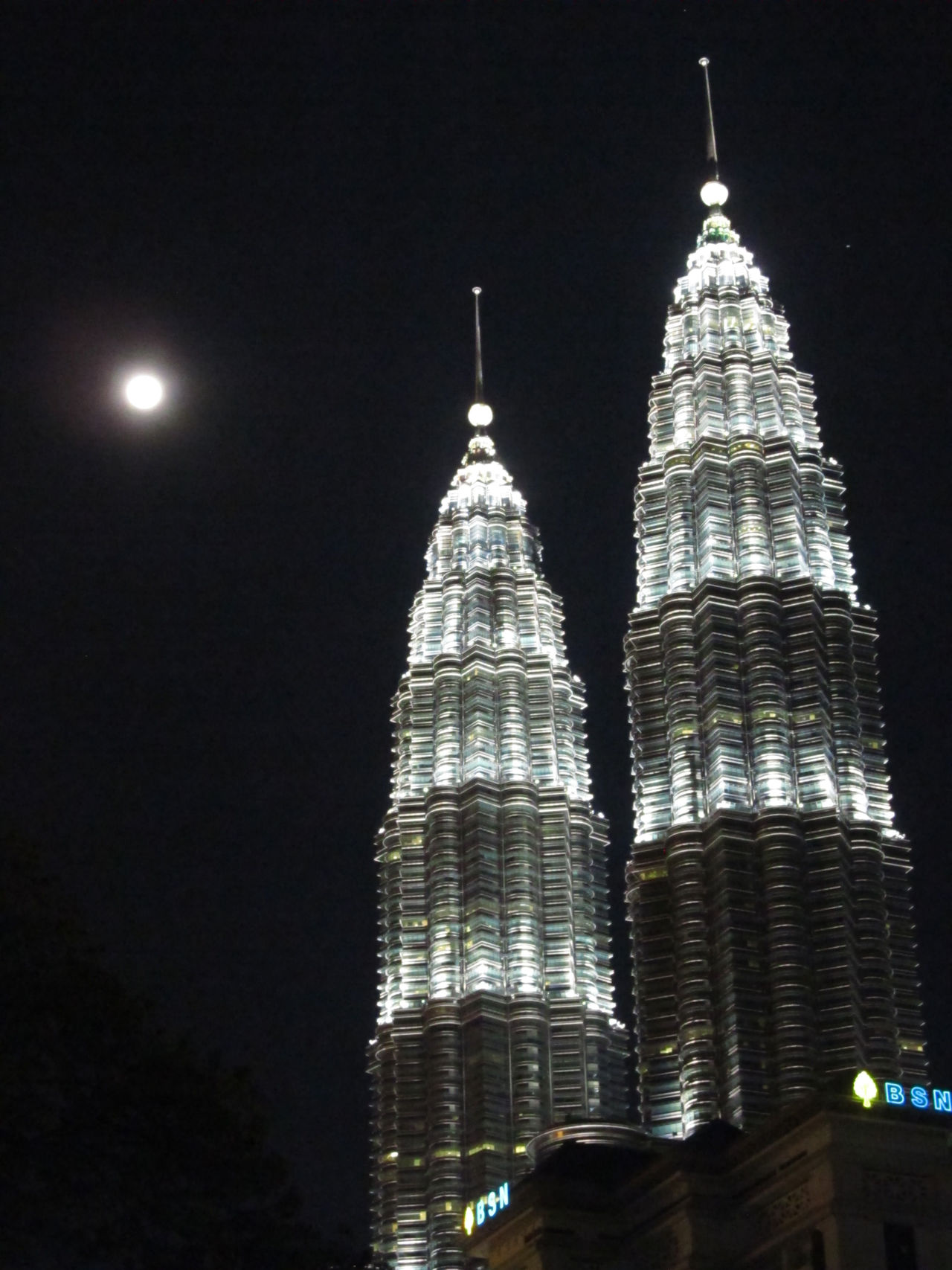 KLCC, Petronas Twin Towers at night with a full moon, Kuala Lumpur, Malaysia City Lights Full Moon Klcc Klcc At Night KLCC Park KLCC Tower KLCC Twin Towers Kuala Lumpur Kuala Lumpur Malaysia  Moon Night Shot Petronas Twin Towers Tourism Travel Travel Photography